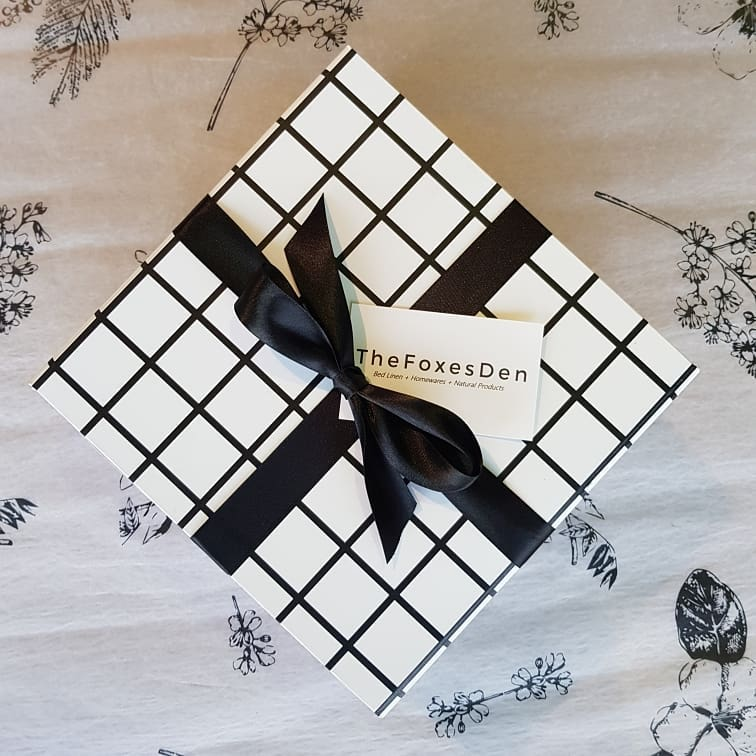 Close-up of black and white checked out with a black ribbon bow