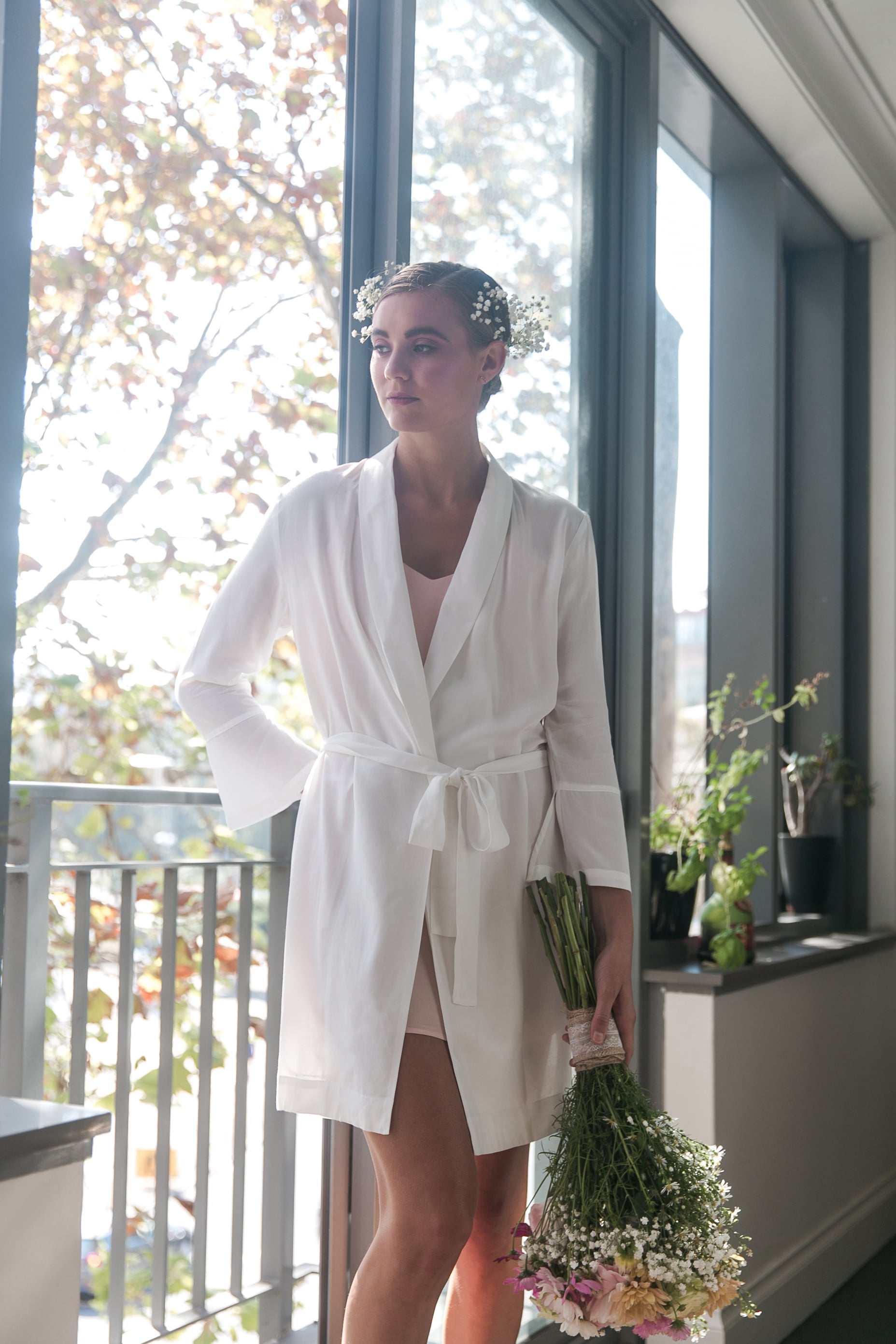 Model dressed in white bridal robe