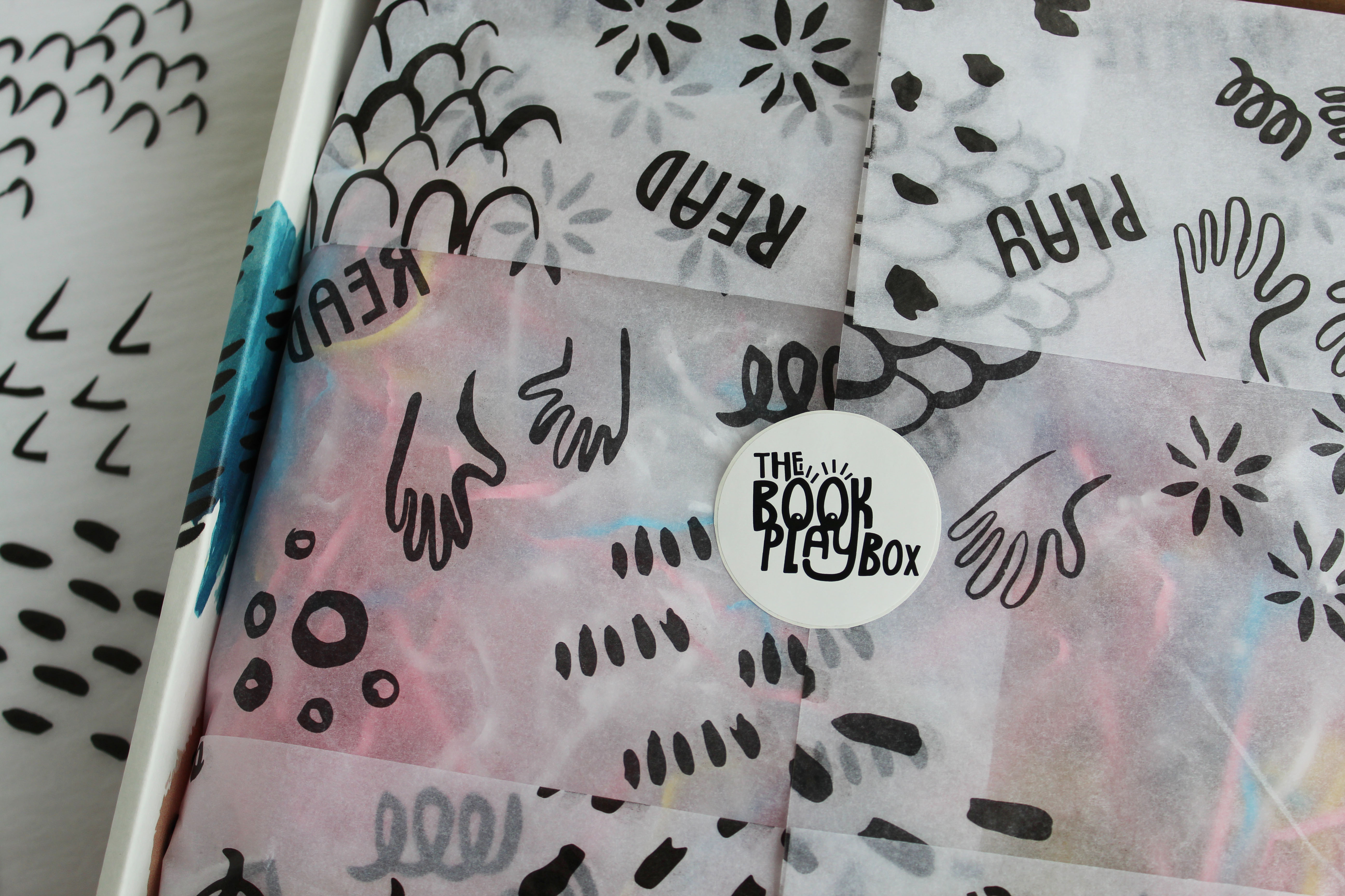 Close-up of The Book Playbox custom sticker